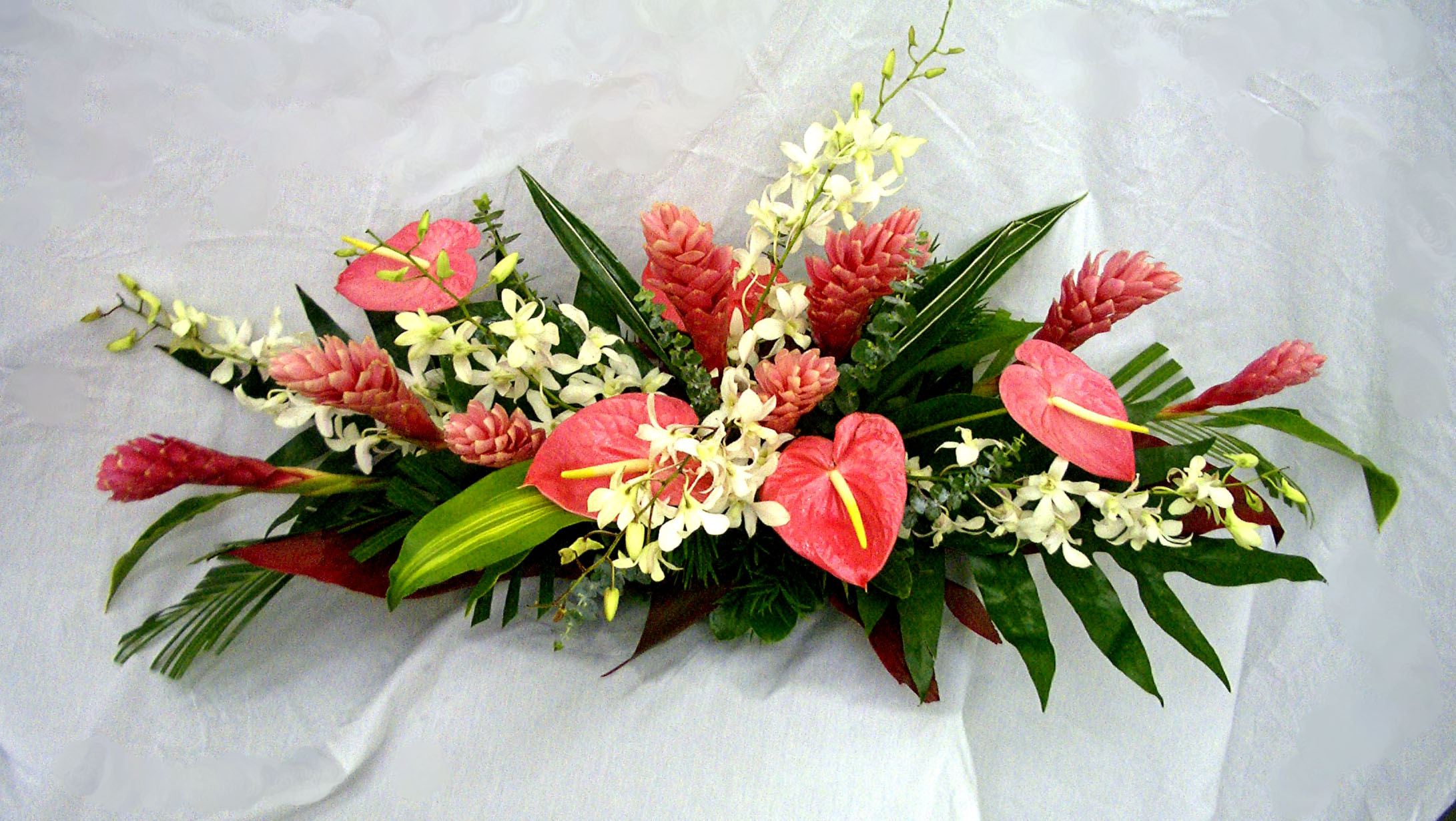 Click To Enlarge**Pink Long And Low Tropical Centerpiece $14995 This